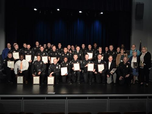 group photo of officers and civilians who received awards
