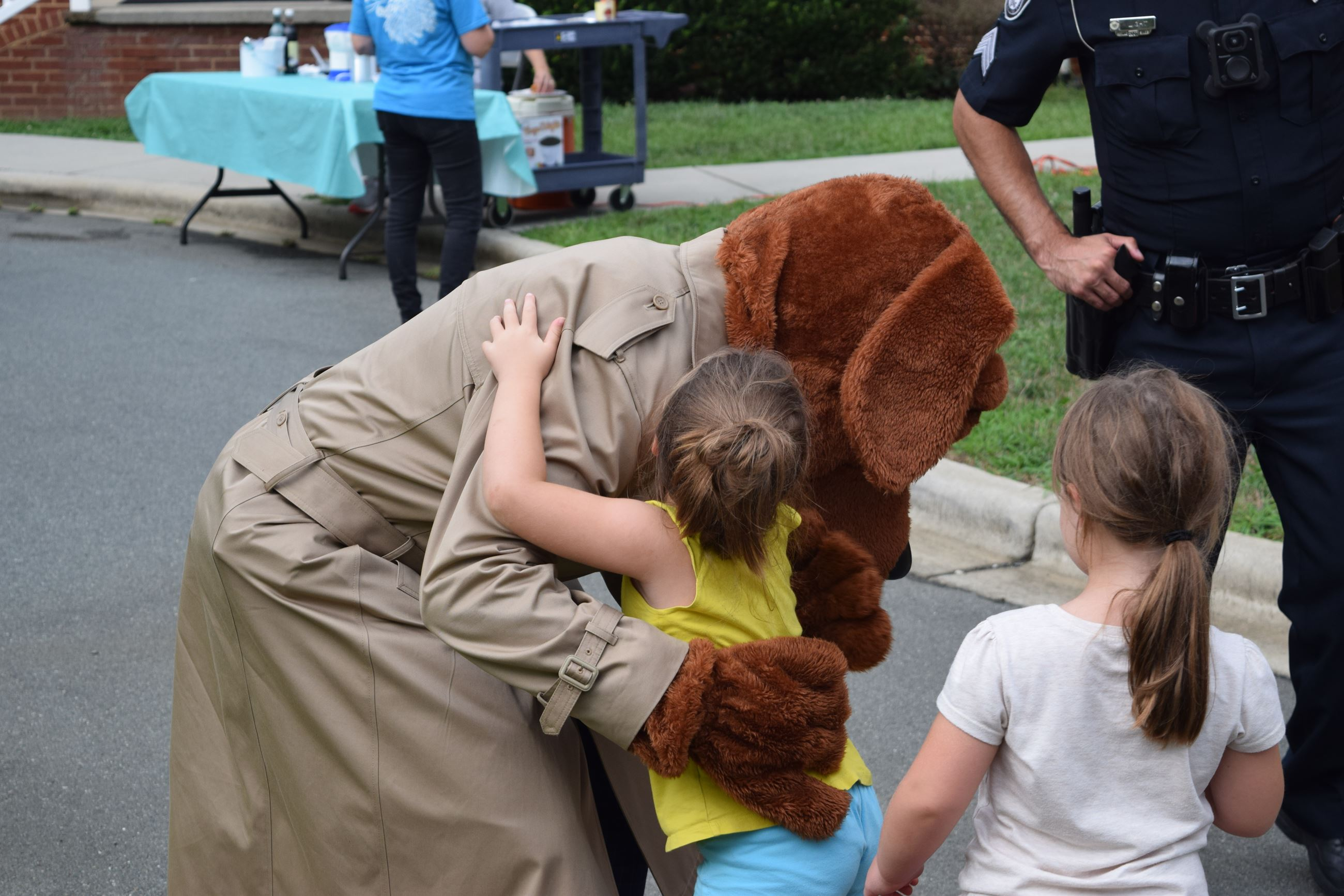 child hugs mcgruff